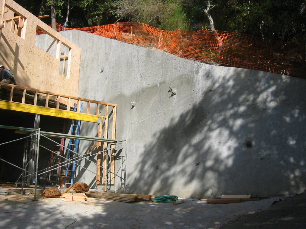 Tieback retaining wall the garage.