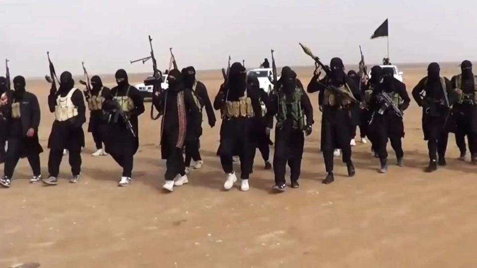 Fighters from the Islamic State in the Iraqi Desert. Via: abc.net.au