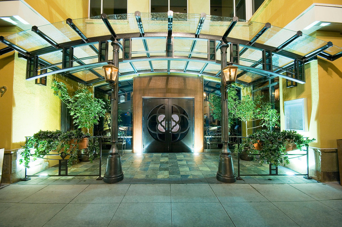 Primary entrance on Colorado Boulevard featuring a curved glass canopy.