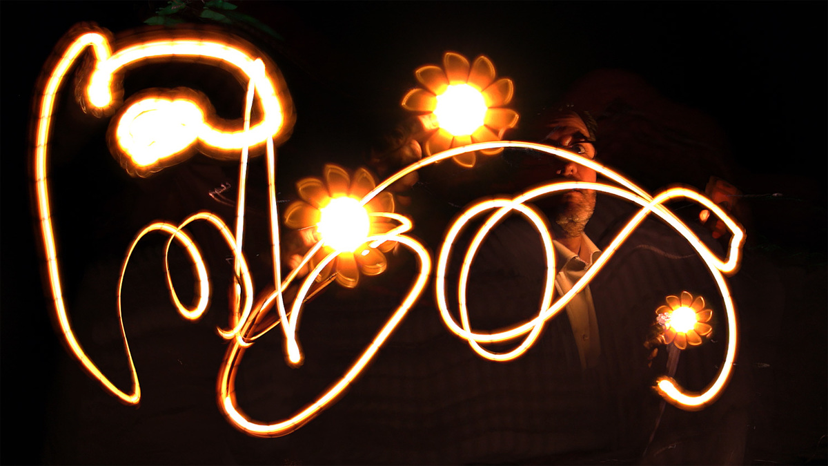 Olafur Eliasson creating light graffiti. Image courtesy of MIT Council for the Arts.