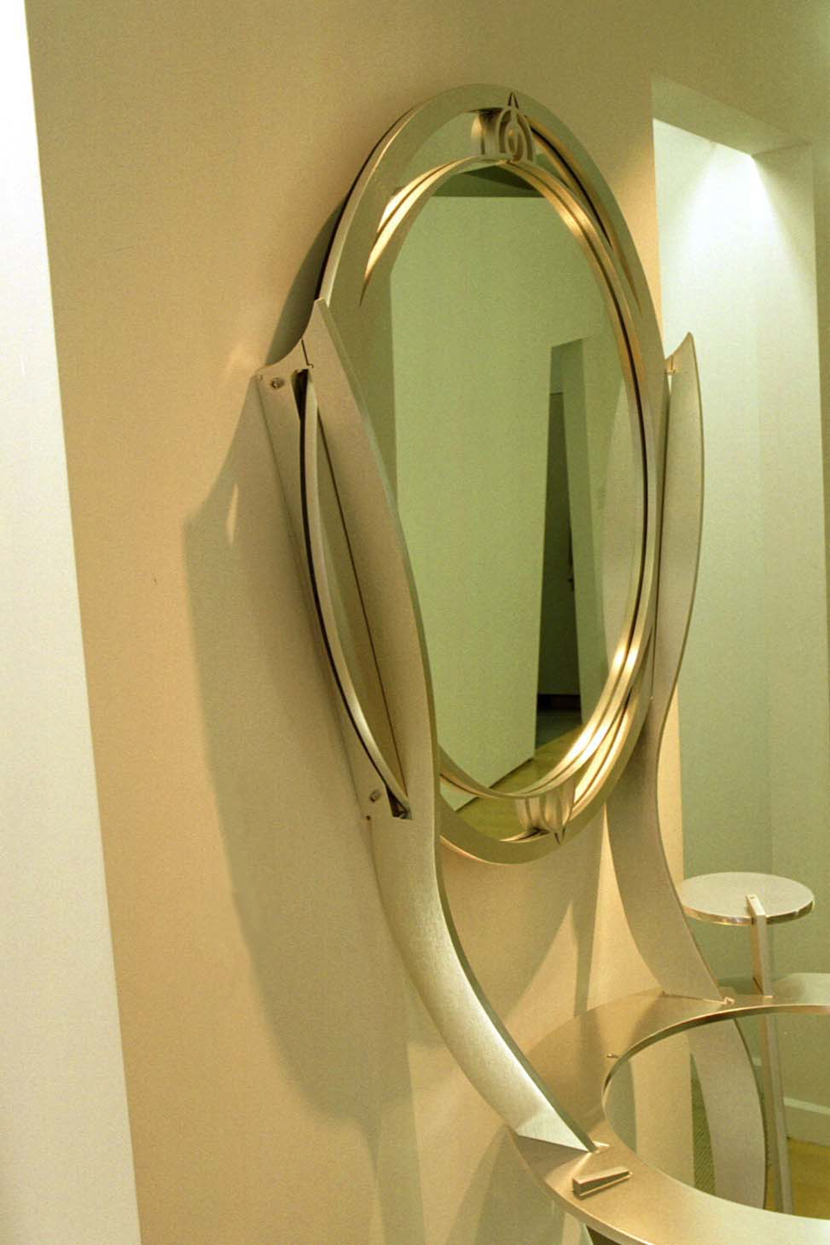 Sink and Mirror made from waterjet cut Aluminum-interlocking parts.