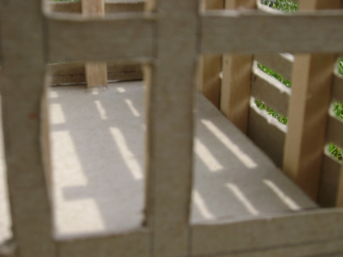 A close up photo. This showed how people within could look out and examine the environment from within. Also, nature could look in on the people within the building.