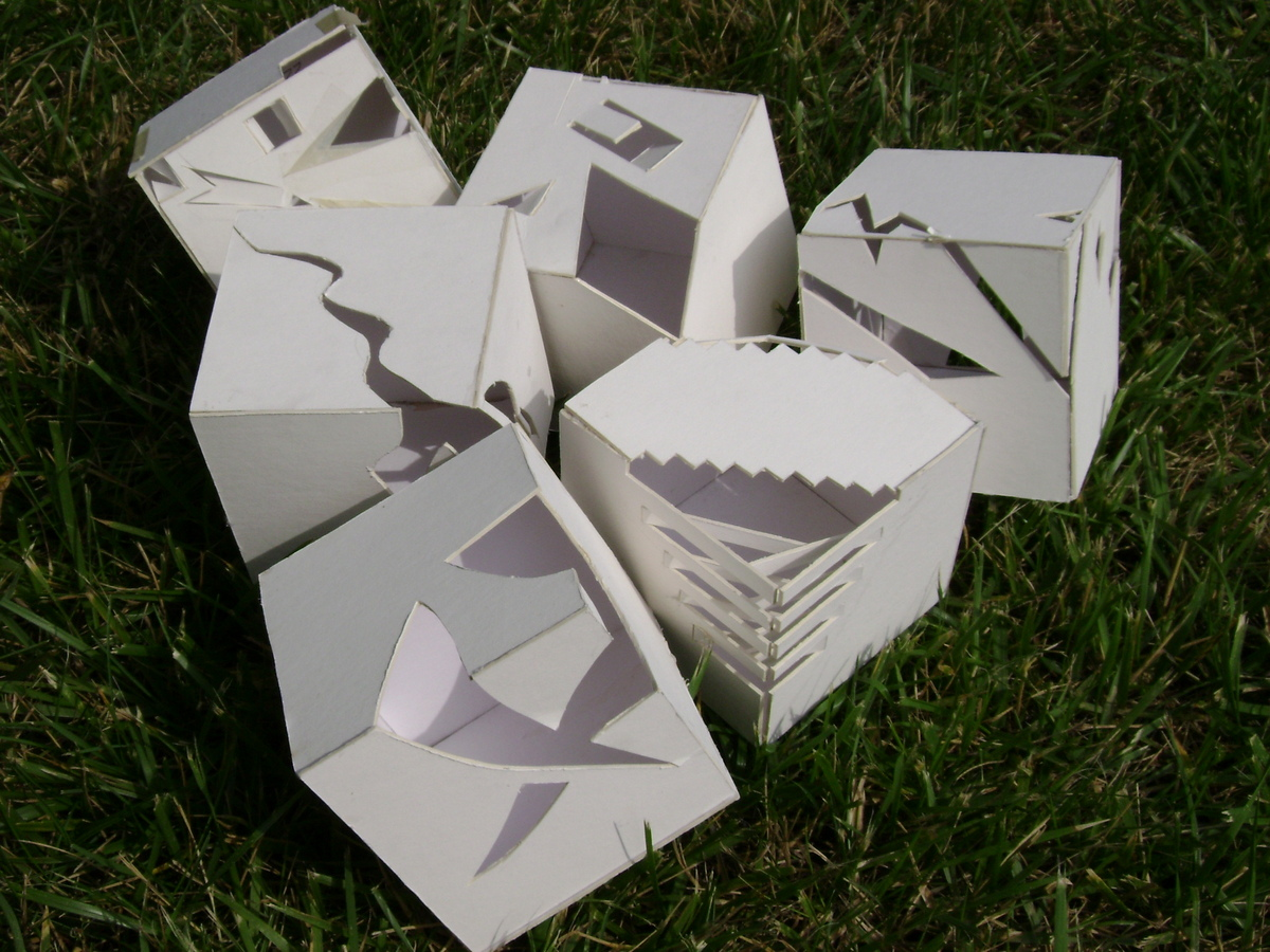 All six cube designs showing the process throughout the semester towards ones that embodied a space for a poet, painter, and musician.
