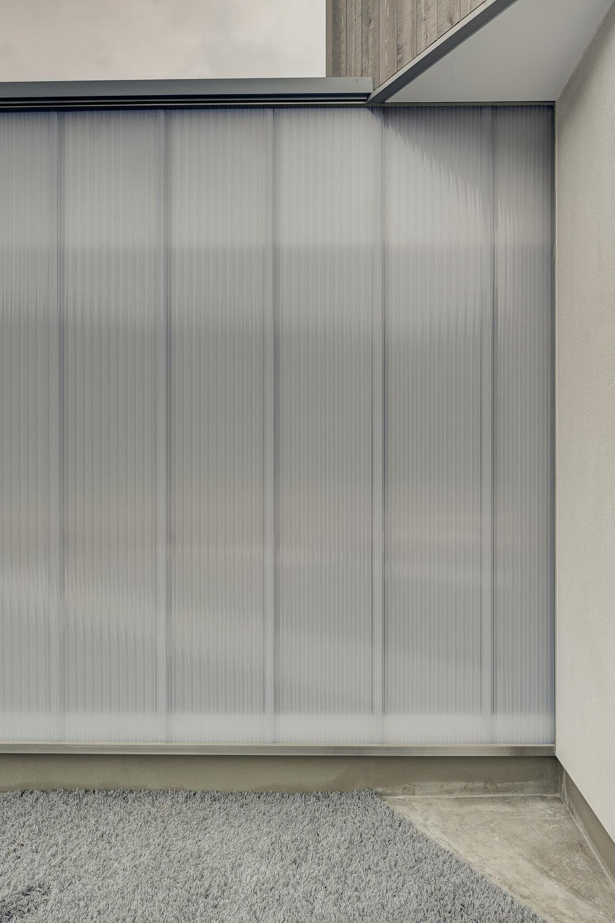 Orandajima House exterior detail view of polycarbonate panel