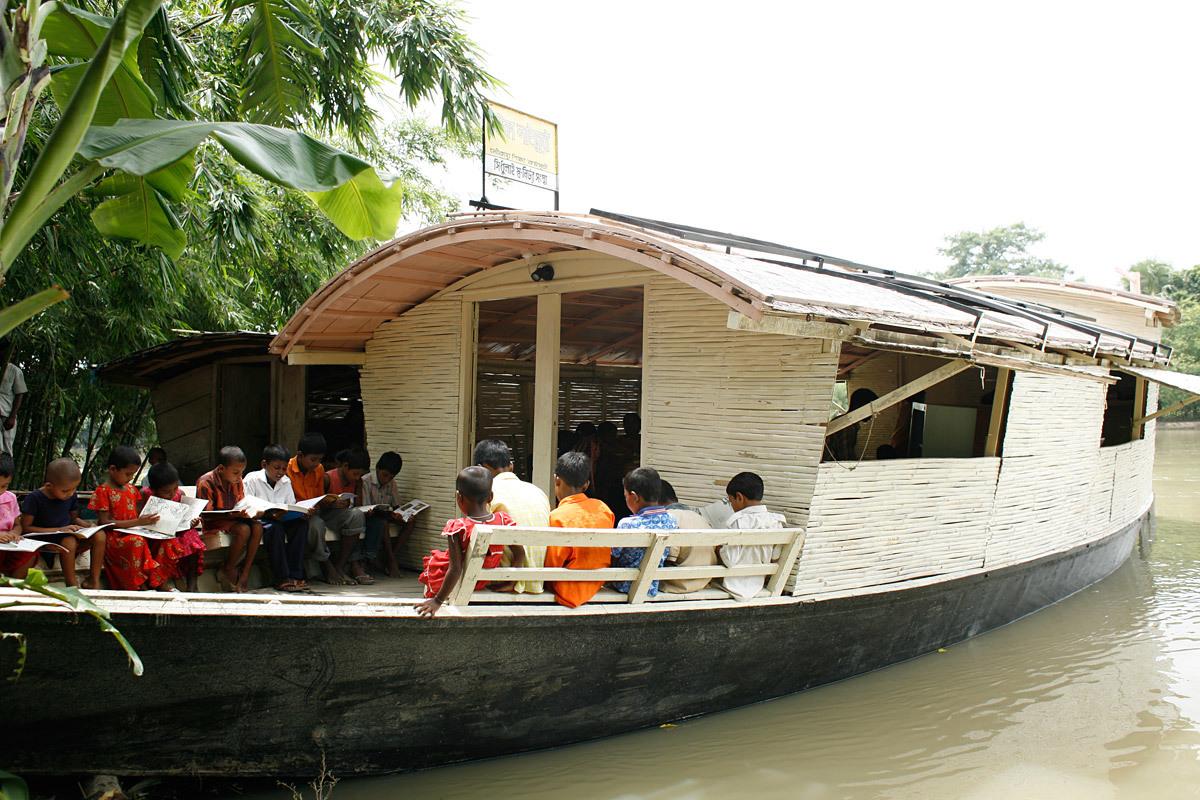 Floating Community Lifeboats: Architect: Mohammed Rezwan (Bangladesh). Implemented by Shidhulai Swanirvar Sangstha on the Atrai, Barnoi, Gurnoi, Nandhakuja, Gumani, and Boral Rivers in Natore, Pabna, and Sirajganj districts, Bangladesh, 2002-present. Sal wood and other woods, plywood, bamboo, angle iron, iron sheet, flat bar. Photo: © Abir Abdullah/Shidhulai Swanirvar Sangstha