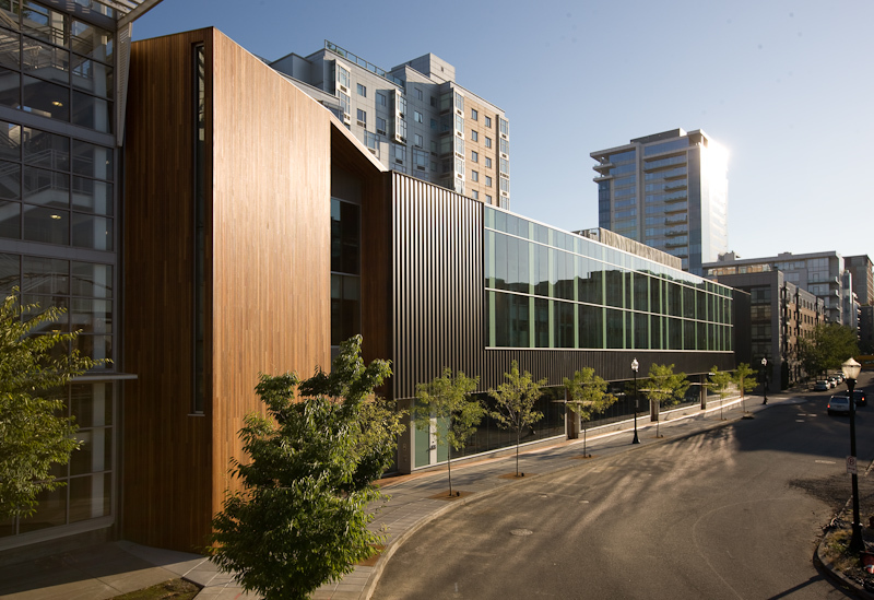 Metal panel & glass curtainwall box wrapped and supported with a Cumaru wood podium