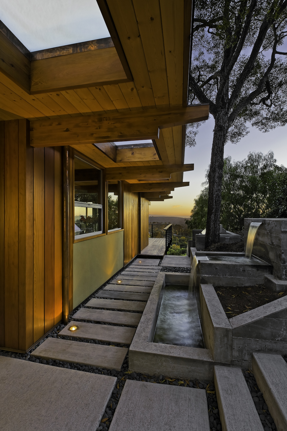 1950's mid century modern hillside home. full restoration | addition | modernization. board formed concrete | clear wood finishes | mid-mod style.