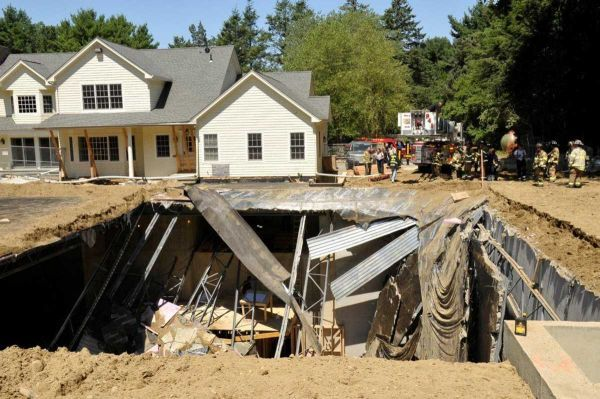 Two construction workers fell about 40 feet after the roof of an underground basketball court in Brookville they were working on collapsed. (July 27, 2011) (Credit- Kevin Imm)