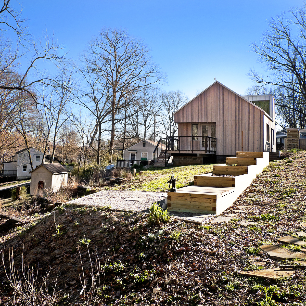View of vegetable beds and gravel plinth from community path. Photo credit: Ken McCown