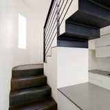 Shot of the steel stairs to gallery via Ellito Lazarus