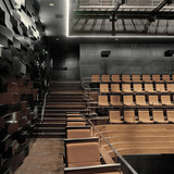 The side balcony of the small auditorium. The material for the wall is black GRG, and the balconies are made of solid bamboo. (Photo: Jussi Tiainen)