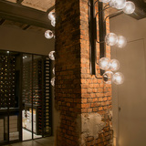 Lighting and interior detail of The Jane restaurant, a former chapel for a military hospital in Antwerp. Photo courtesy of .PSLAB.