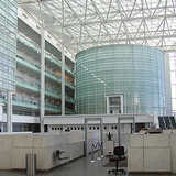 Visitors to the Sandra Day O'Connor Federal Courthouse pass through a very uncourtlike glass enclosed atrium which could aptly be described as a hothouse. The cylindrical glass center point houses a ceremonial courtroom. (Image via http://www.doney.net/aroundaz/phoenix-oconnor.htm)