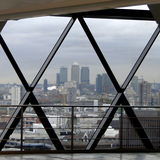 Seen here from the vacant sixteenth floor of 30 St Mary Axe, the large skyscrapers of Canary Wharf constituted a new business district to the east of the City. Photograph by author.