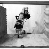 Fig 4: stacked plywood being milled by six-axis robotic arm
