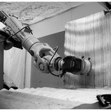 Fig 5: stacked plywood being milled by six-axis robotic arm