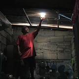 Liter of Light: Solar bottle bulb entrepreneur Mang Demi has already installed more than 10,000 lights in Manila (Photo: Jun de Leon)