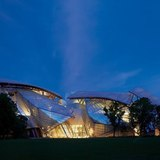 The Fondation Louis Vuitton, which opens to the public in October, lights up the Bois de Boulogne by Hufton and Crow.