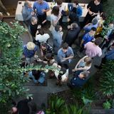 Partiers in the courtyard, as photographed from the second story balcony off the guest bedrooms. Photo by Diana Koenigsberg (www.dianakoenigsberg.com)