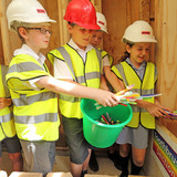 Over 700 school children visited the construction site. Students from St. Andrew's Primary school visited the house to learn about carbon neutral building, and also brought their own old toothbrushes to be used as wall insulation in the house. Photo courtesy of Duncan Baker-Brown.
