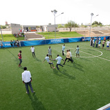 Playing on the pitch at the Katutura Football for Hope Center. Location: Windhoek, Namibia. Credit: Marcus Weiss