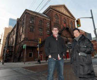 Innovative Technologies librarian Graham McCarthy (left) and Architectural Science professor Vincent Hui in front of Massey Hall, one of the 93 buildings included in the database of a new architecture app developed by the pair.