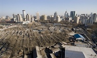 Skyscrapers and modern buildings stand behind a traditional Chinese housing complex in Beijing. Photograph: Diego Azubel/EPA, via theguardian.com