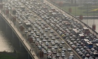 """'Ten years ago American planners told Beijing: """"Don't eliminate cycle lanes for cars! We made that mistake!"""" But they didn't listen' ... traffic in Taiyuan. (The Guardian; Photograph: Corbis)"""