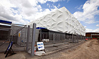 Exterior of the completed basketball stadium on the Olympic site, east London. Photograph: Felix Clay