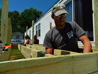 Student Brice Holmes constructs the deck of Beilke's home.