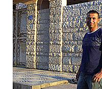 Real estate broker Essam Mortja in front of a Gaza home. (Reese Erlich / Marketplace)