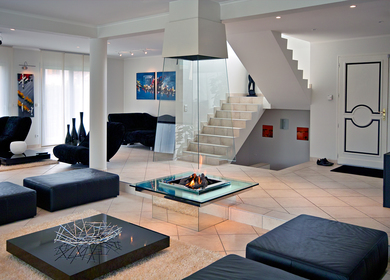Pyramidal free hanging glass fireplace