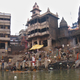 Manikarnika Ghat, her pile of charcoal, blackened temple and two eternal waiting rooms