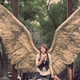 an immense pair of bronze wings is a popular photo spot